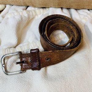 Vintage distressed brown leather belt .